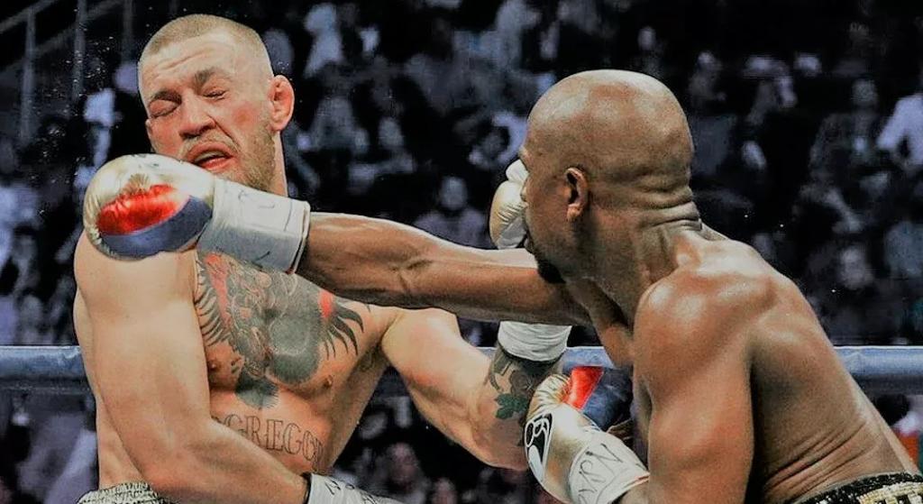 Поражение Конора в боксерском поединке Мейвезеру